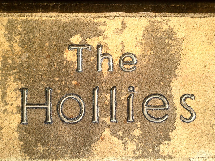 The Hollies Sign